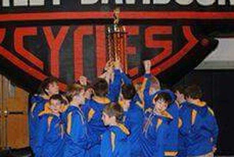 Collected Community Wrestling Team  First Place  Working Hard Reaching Goals Proud Parents Great Coaches Distortion