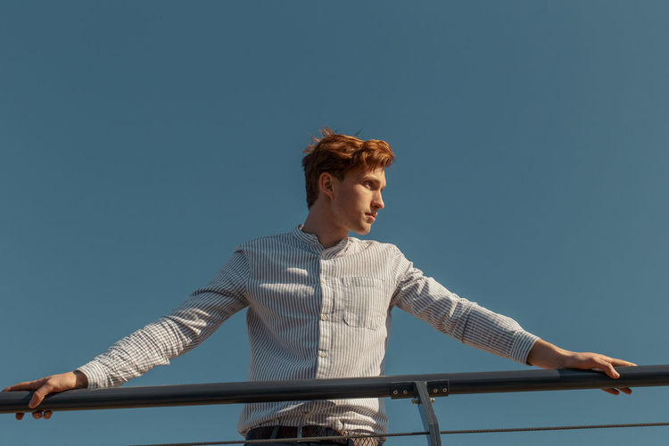 Myroslav #18 The result of a spontaneous hour-long shoot during the first meeting with the person, Hot Summer Day Redhead Sailing Ship The Week on EyeEm TheWeekOnEyeEM Casual Clothing Clear Sky Editorial  Leisure Activity Lifestyles Looking Away Model Test Shoot Real People Sail Sailing Sailing Boat Standing Yacht Yachting Yachtlife Young Adult Young Men