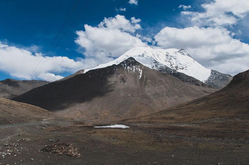 Tibet Travel Destinations Mountain Snow Power In Nature Snowcapped Mountain Cold Temperature Sky Landscape Mountain Range Cloud - Sky Travel