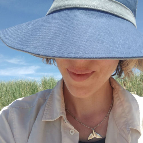 Close-up of woman wearing hat while smiling outdoors