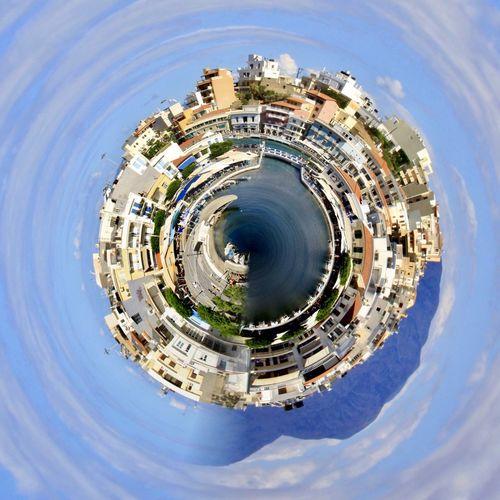 Digital composite image of buildings in city against sky