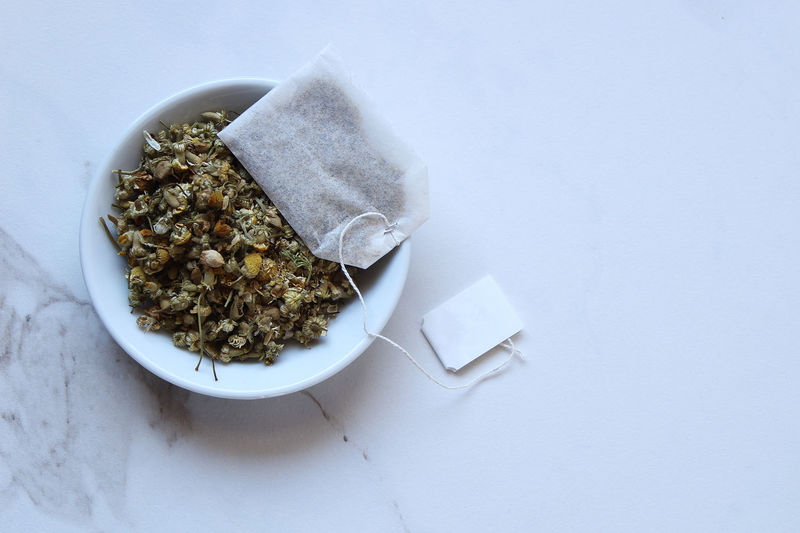 Chamomile tea leaves Chamomile Herb Ingredients Tea Close-up Concept Copy Space Dried Flowers Dried Plant Food And Drink Indoors  Loose Tea Marble Nature No People Plant Still Life Studio Shot Tea Bag