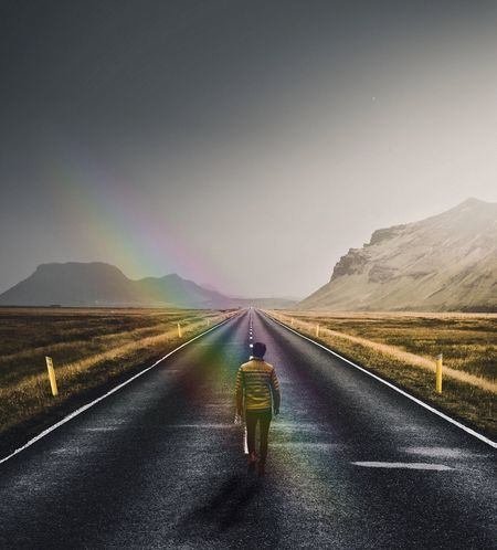 Country Road Day Diminishing Perspective Direction Environment Full Length Landscape Marking Nature One Person Outdoors Real People Rear View Road Road Marking Sign Sky Symbol The Way Forward Transportation vanishing point