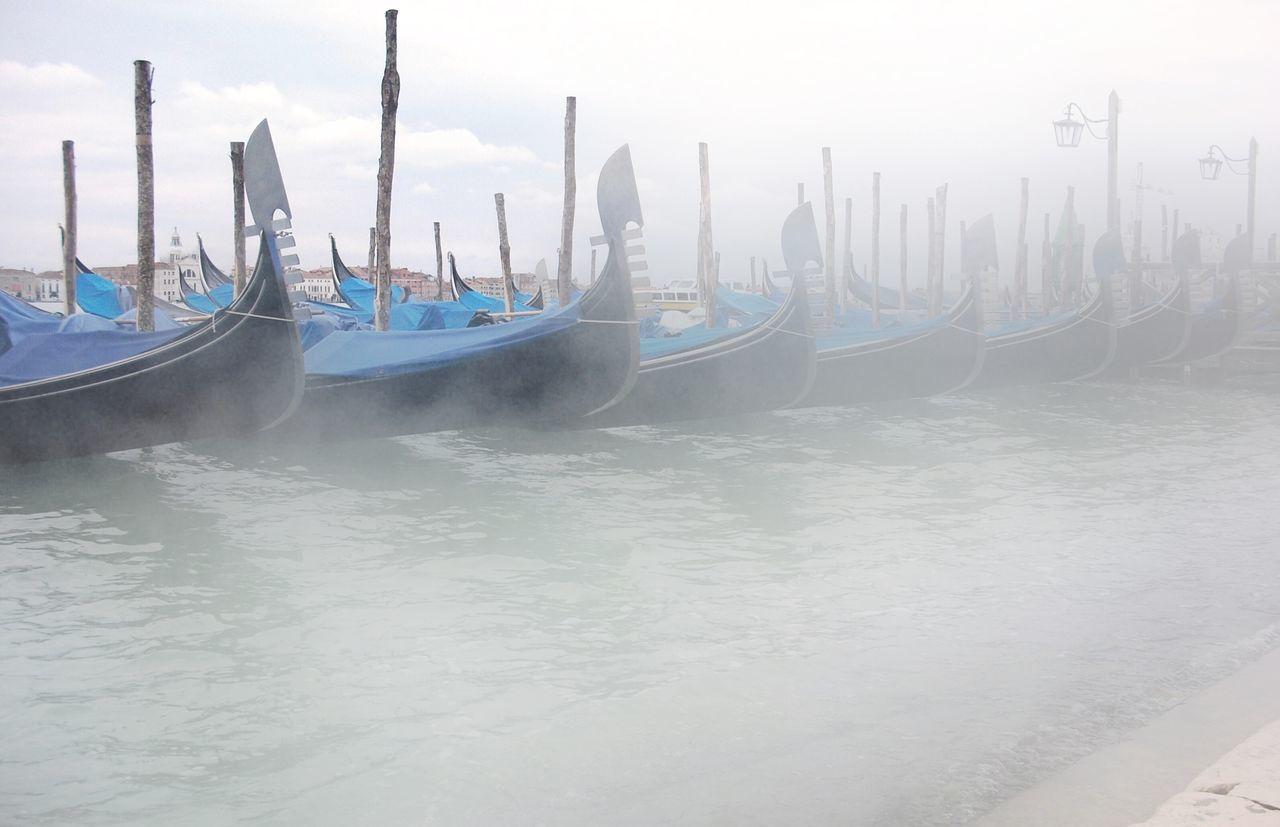 Docked Gondolas In Row Against The Sky