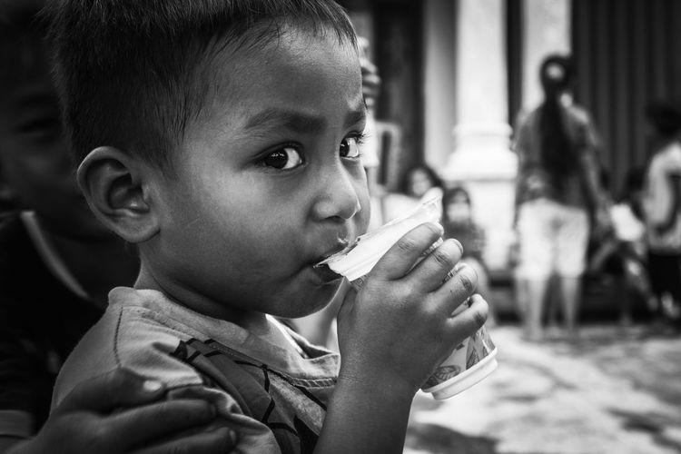 Small children drink water