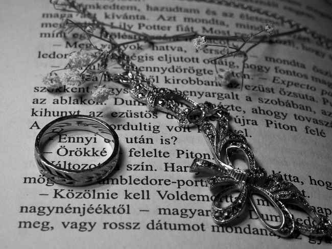 Text Jewelry No People Close-up Indoors  Metal Western Script Communication Emotion Still Life Paper Ring Religion Law Key Spirituality Healthcare And Medicine Old Publication