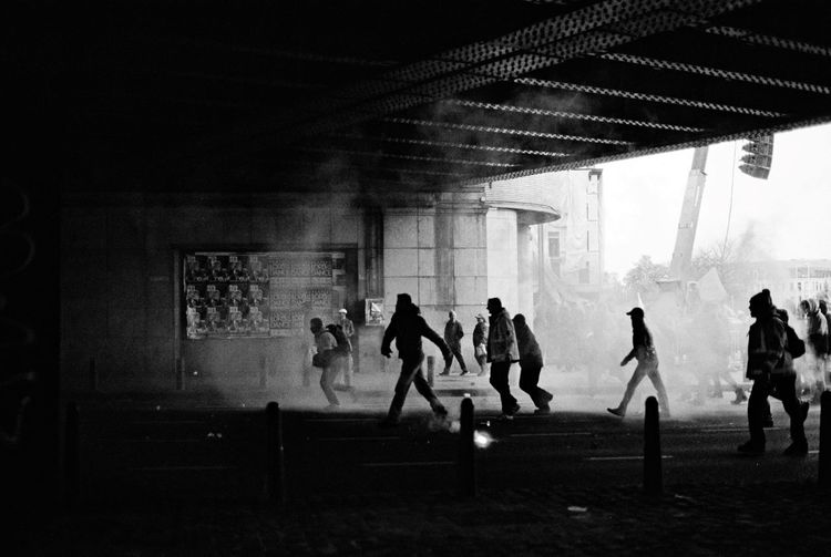 2014 Stories From The City CityStories City Life Smoke - Physical Structure Smoke Black And White Angry Violence Tunnel View Manifestation Built Structure Architecture Real People Men Indoors  EyeEmNewHere People