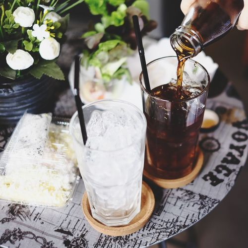 Cold Brew Coffee Human Hand Drinking Glass Indoors  Drink Food And Drink Preparation  Ice Cube Close-up Freshness Healthy Eating