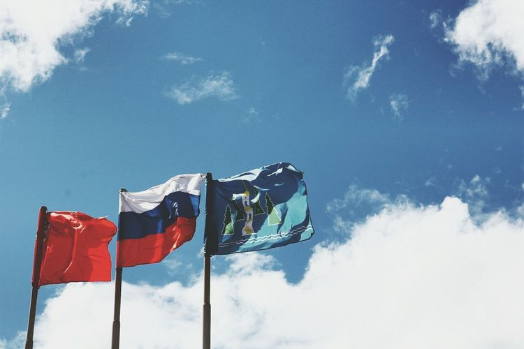 Low angle view of russian flag against sky