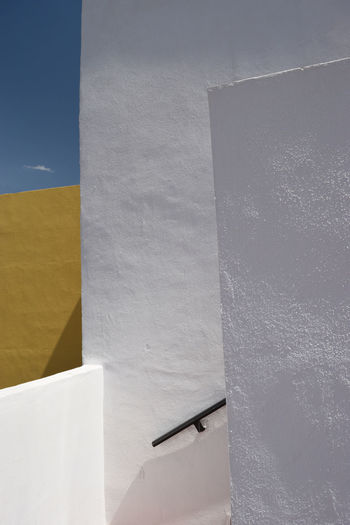white walls on blue sky background Africa Architecture Blue Sky Building Built Structure Details Minimalism Outdoors Sunshine Traditional