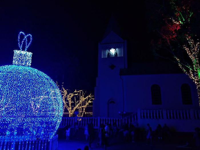 Illuminated christmas lights in building at night
