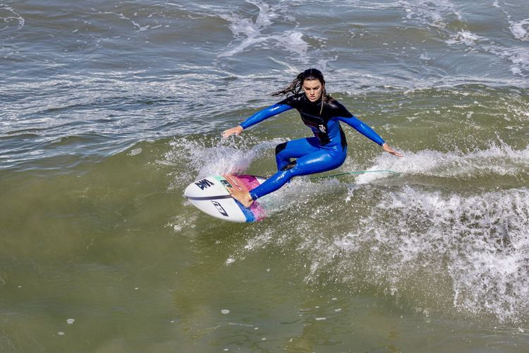 professional surfer Serena Nava surfing off of the coast of Huntington Beach, Orange County, California Water Leisure Activity One Person Lifestyles Sport Real People Motion Waterfront Sea Full Length Aquatic Sport Nature Beauty In Nature Day Surfing Young Adult Wave Adventure Outdoors Serena Nava Surfer Surface Level Buell Wetsuits DMA Surfboards Huntington Beach Orange County California Southern California Professional Athlete Woman Female Athlete Water Sport Surfboard