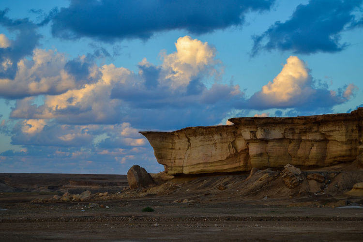 Rock formation at Al Wajh Cloud - Sky Sky Scenics - Nature Land Rock Formation Tranquil Scene Rock Nature Environment Landscape Tranquility Non-urban Scene Solid Rock - Object Beauty In Nature Travel Destinations No People Travel Desert Geology Outdoors Arid Climate Climate Eroded