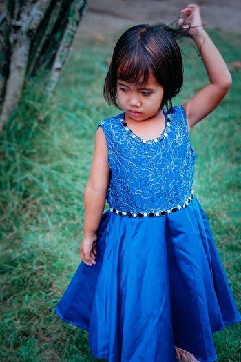 Portrait of a girl on field