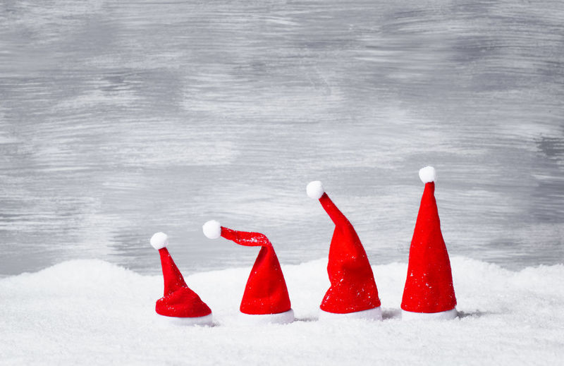 Red flags on snow covered landscape during winter