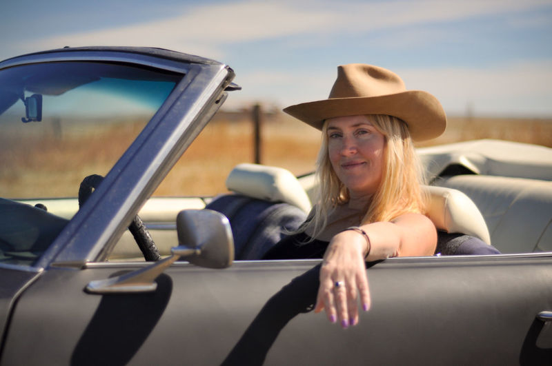 Car Motor Vehicle Portrait Smiling Land Vehicle Sitting Travel Cowboy Hat Hair Beautiful Woman Road Trip One Person Happiness Hat Convertible Classic Car Cowgirl Sunlight Rural Scene Countryside Country Western Driver Joyride Blonde