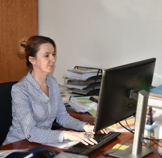 Woman Using Computer At Office