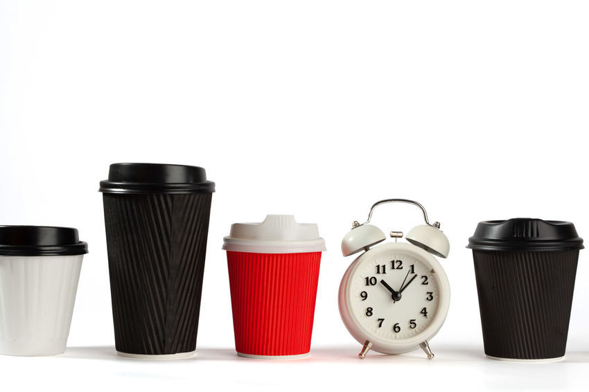 Coffee break concept depicted with vintage alarm clock and plastic coffee cups in a row on white background with copy space Coffee Time Copy Space In A Row Retro Alarm Clock Black Color Clock Close-up Coffee Break Coffee Cups Coffee Cups In A Row Container Copy Space Cut Out Disposable Cups Food Food And Drink Group Group Of Objects In A Row Indoors  No People Recyclable Items Red Side By Side Still Life Studio Shot Table Template Time Vintage White Background