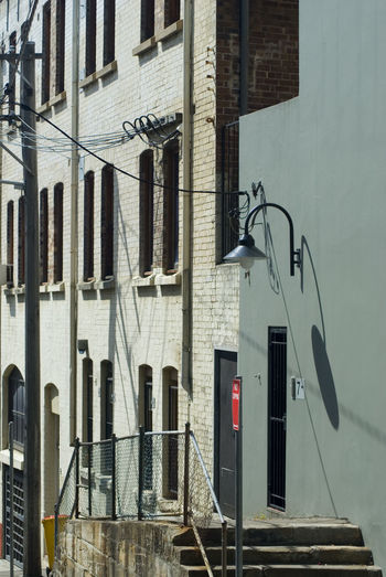 street scene with a door to the rear of a building Architecture Australia Back Door Building Building Exterior Cables Chippendale Door Harsh Lighting Old Street Swan Neck Lamp Sydney Windows Wires