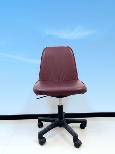 Low angle view of chair against sky