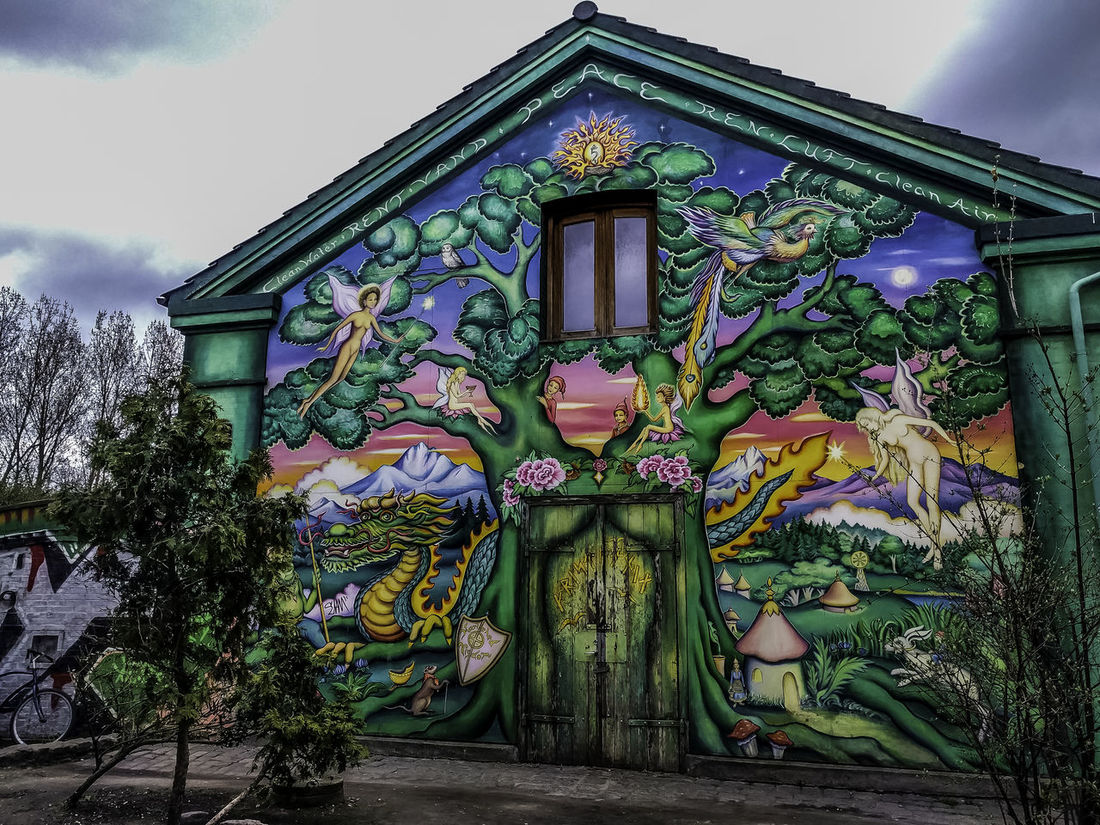 Colorful House at Christiania Copenhagen, Denmark Christiania Christiania, Denmark Comunity Copenhagen, Denmark DIY Denmark Drug Drugs Freedom Graffiti Travel Photography Art And Craft Colorful Graffiti Art Grafitti Hand Painted House Low Angle View The60s Travel Destinations