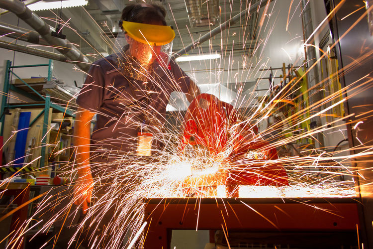 Working hard Cutting Factory Firework Heat - Temperature Industry Manual Worker Metal Metal Industry Metal Saw Metalwork One Man Only One Person Safety Safety Mask Graffiti Saw Skill  Sparks Worker Working Workshop