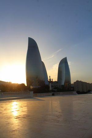 Tower of Fire, Baku, Azerbaijan Azerbaijan Baku Architecture Azerbaycan Building Exterior Built Structure City Cityscape Day Modern No People Outdoors Silhouette Sky Skyscraper Sun Sunset Tower Of Fire Travel Destinations Urban Skyline
