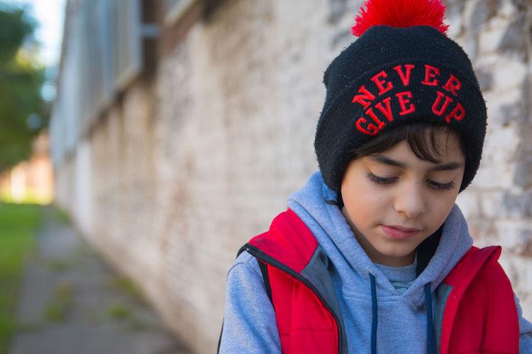 Portrait of teenage boy wearing hat