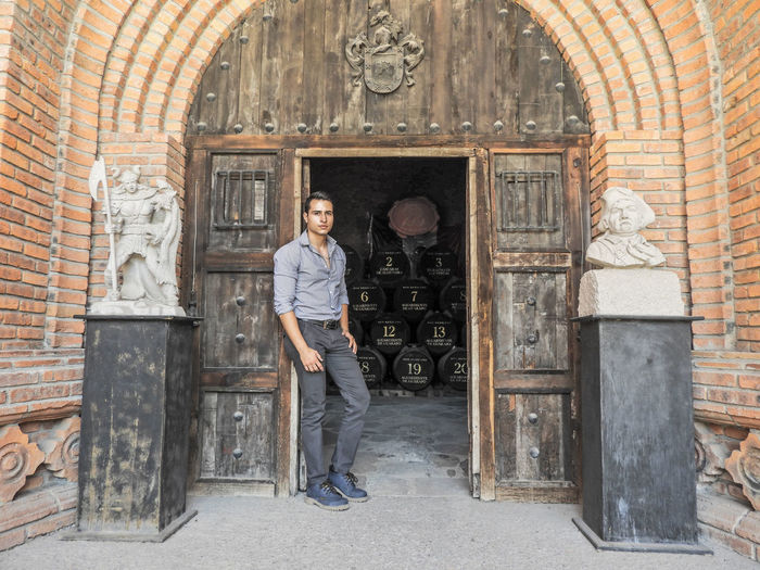 Portrait of man standing at wine cellar entrance
