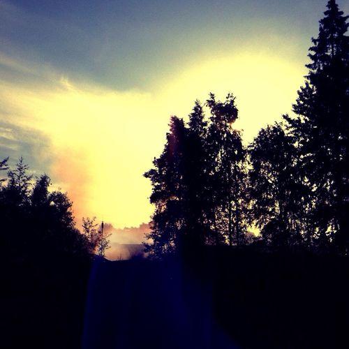 Morning light through smoke from burning building. Nature Morning Light