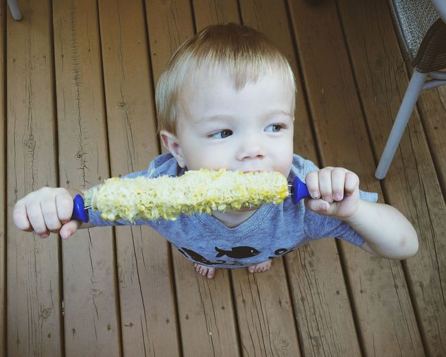 Cute Smiling Child Eating Corn Barbeque BBQ Summer Picnic Food American