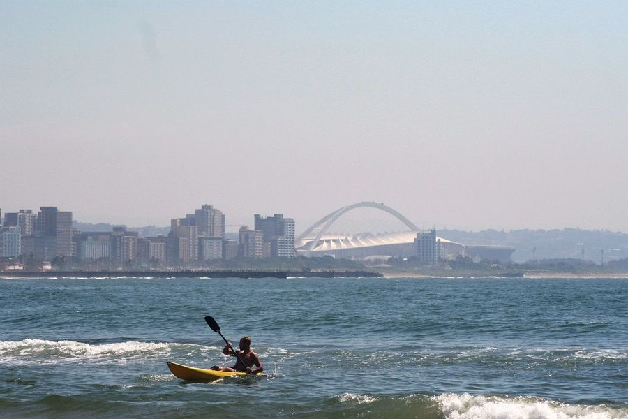 Architecture Blue Wave Boat Built Structure Capital Cities  City City Life Cityscape Durban South Africa Kayak Kayaking Leisure Activity Mode Of Transport Moses Mabhida Stadium Nautical Vessel Tourism Travel Destinations Vacations Water Alternative Fitness Lost In The Landscape Be. Ready.