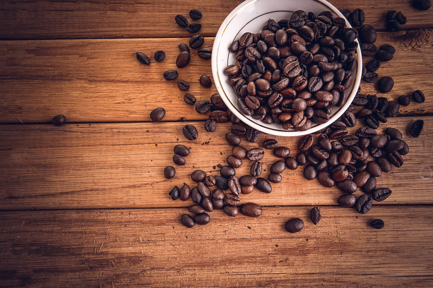 Coffee beans Brown Coffee - Drink Coffee Bean Coffee Cup Cup Drink Espresso Espresso Maker Food Food And Drink Freshness Group Of Objects High Angle View Indoors  Large Group Of Objects Milk No People Preparation  Raw Coffee Bean Refreshment Roasted Roasted Coffee Bean Scented Table Wood - Material