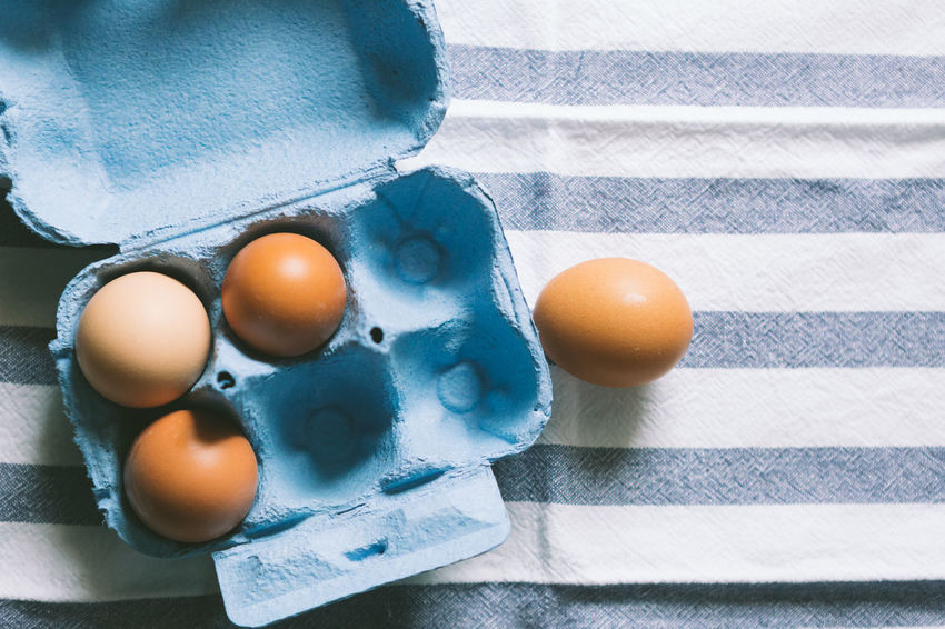 Food Egg Freshness Food And Drink Wellbeing Healthy Eating No People Indoors  High Angle View Still Life Table Close-up Raw Food Egg Carton Egg Yolk Directly Above Sunlight Vulnerability  Tablecloth Nature