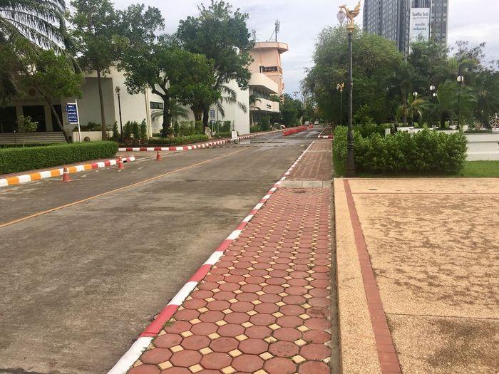 Empty road by street in city