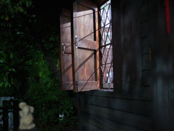Open Shutters Of Illuminated House Windows