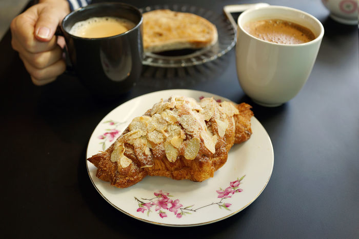 Almond crossaint with coffee Almond Tree Breakfast Lunch Meal Tea Bakery Bread Cafe Close-up Coffee - Drink Coffee Cup Crossaint Food Food And Drink Meakeup Pastry Plate Ready-to-eat Refreshment