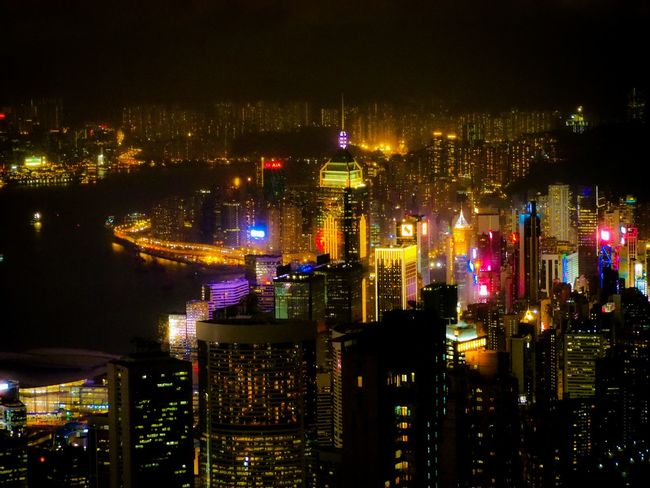 Hongkong at Night City Cityscape Illuminated Urban Skyline Skyscraper Multi Colored City Life Business Finance And Industry Downtown District Sky