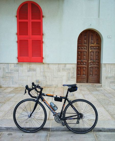 Red passion Bike Italy City Red Bicycle Stationary Door Architecture Building Exterior Built Structure