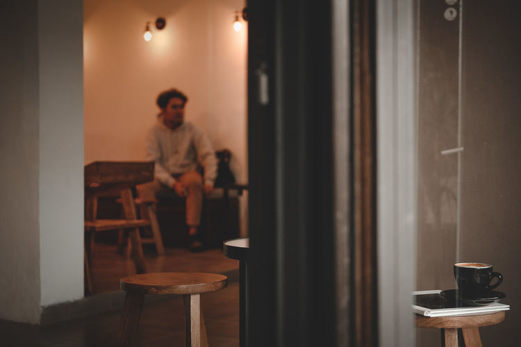 man and coffee Coffee Man Sitting Cappuccino Lights Coffeeshop Home Interior Drink Full Length Domestic Room