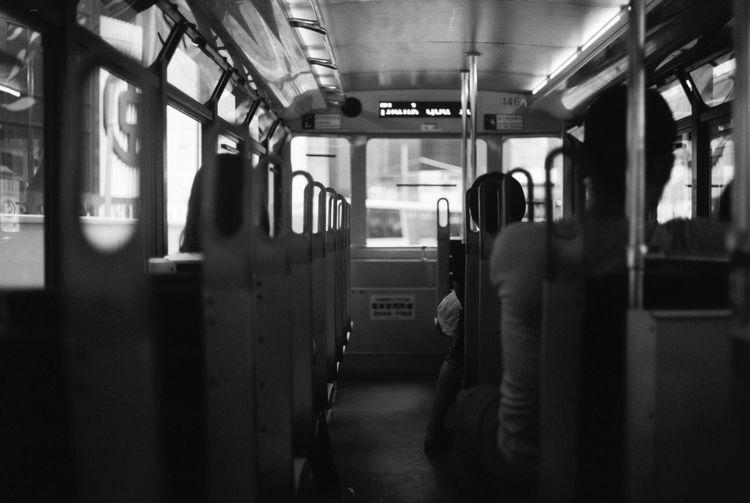Hong Kong Tram Kodak T-max 100 Canon AE-1 35mm Film Black And White Photography Tram Hong Kong Public Transportation Mode Of Transportation Transportation Rail Transportation Train Real People Train - Vehicle Travel Vehicle Interior Journey Passenger