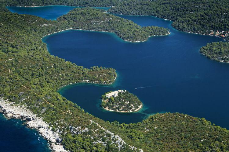 High angle view of island amidst sea