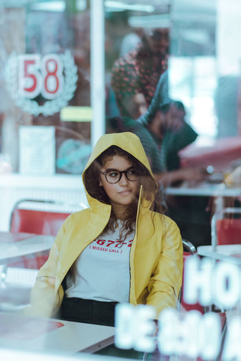 No reason. Day Eyeglasses  Front View Indoors  Leisure Activity Lifestyles Occupation One Person People Real People Retail  Standing Store Yellow Young Adult Young Women