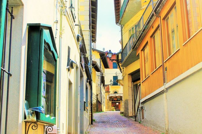 City Cityscape Paint The Town Yellow Alley Architecture Building Building Exterior Built Structure Citylife Day Italianeography Italy No People Outdoors Residential Building Sky Street The Way Forward Warm Light Yellow Yellow Color