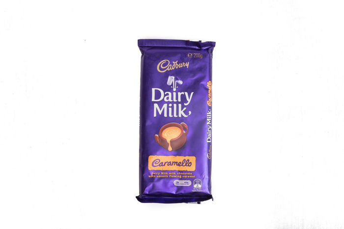 Cadbury Chocolate isolated on white background Bubbly Cadbury CadburyDairymilk Chocolate Dark Chocolate Hazel Isolated Almond Bite Brand Caramel Cream Creamy Dairy Milk Editorial  Food Hazelnut Illustrative Milk Nut Old Gold Roast Sweet White White Background