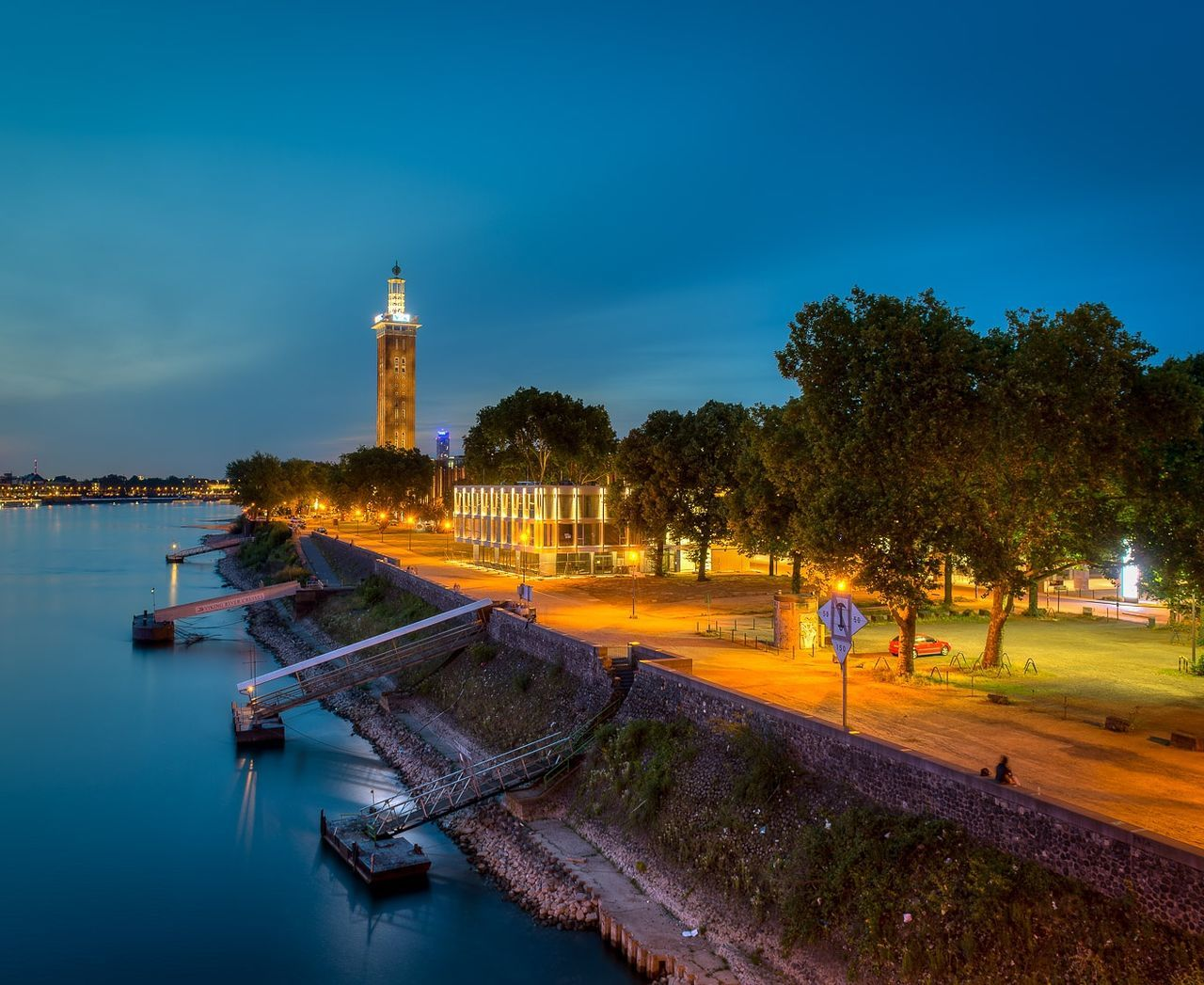 architecture, tree, built structure, building exterior, water, sky, outdoors, real people, illuminated, night, lighthouse, nautical vessel, nature