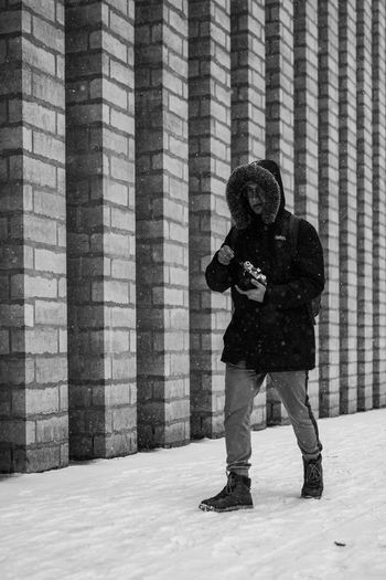 Trip Winter Tallinn One Person Full Length Standing Snow Cold Temperature Technology Winter Adult Leisure Activity Clothing Architecture Day Men Real People Front View Wall - Building Feature Warm Clothing Casual Clothing