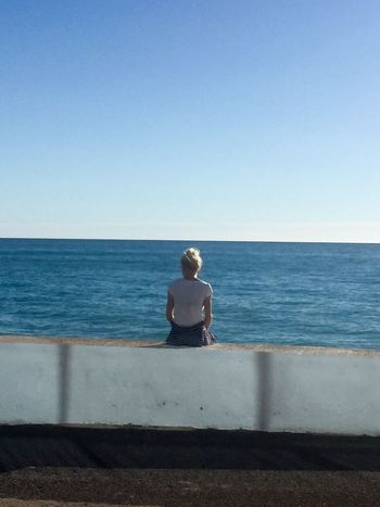 Sea Horizon Over Water Water One Person Full Length Clear Sky Real People Tranquil Scene Sunlight Scenics Sitting Day Young Women Casual Clothing Leisure Activity Blue Beauty In Nature