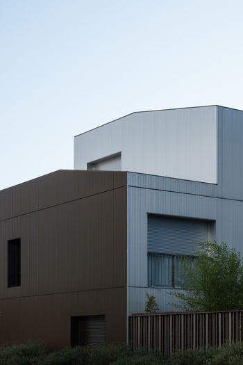 Exterior of modern building against clear sky