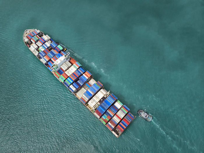 Container cargo ship Container Logistics Aerial View Business Business Finance And Industry Container Day Export Freight Transportation High Angle View Import In A Row Industry Mode Of Transportation Motor Boat Nature Nautical Vessel No People Outdoors Sailing Sea Ship Shipping  Transportation Water